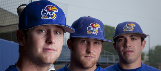 Kansas second baseman Robby Price, left, first baseman Brett Lisher, center, and pitcher Travis Blankenship played together in high school at Free State. The three seniors will play their last home series at Hoglund Ballpark starting tonight.