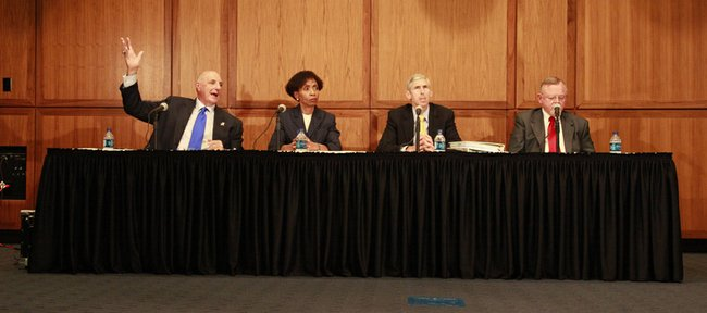 KU Athletic Director Lew Perkins, from left, Chancellor Bernadette Gray-Little, University General Counsel Jim Pottorff and Jack Focht of Wichita law firm Foulston Siefkin prepare to take questions from the media after releasing Foulston Siefkin's investigation into a ticket scandal in KU's athletic ticket office.
