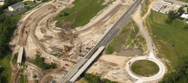This aerial view looks at ongoing reconstruction of the Kansas Turnpike's East Lawrence interchange, which is Exit 204 in North Lawrence. This view looks southwest across the site, with North Third Street cutting across the top of the photo, with the I-70 Business Center at the top of the frame. The interchange is scheduled to reopen for traffic on Wednesday, a month ahead of schedule.