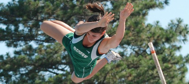 Free State High's Drue Davis glides over the bar during the pole vault competition at the state track and field meet. Davis won the event Friday in Wichita in a state-meet-record 12 feet, 6 inches.