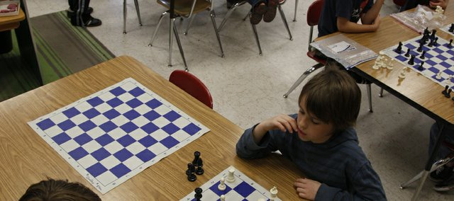 Young chess players of various ages go head-to-head during a meeting of the Cordley Chess Club earlier this month at Cordley School, 1837 Vt.