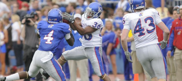Kansas running back Deshaun Sands (36) grabs a pass in front of Blue Team safety Prinz Kande (4) during the first half of the April 24 Spring Game at Memorial Stadium. Sands, son of former KU great Tony Sands, is in the mix at running back this fall, his red-shirt freshman season.