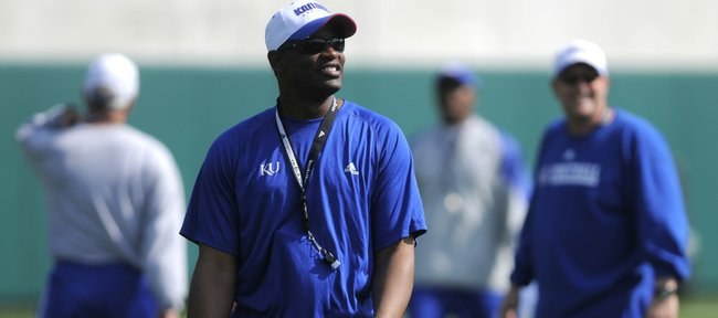 Kansas coach Turner Gill smiles as he walks around the practice field in this April 5 file photo at the KU practice fields. Gill and his staff are putting an emphasis on keeping close tabs on high school recruits in Kansas.