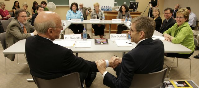 U.S. Sen. Pat Roberts, R-Kan., foreground left, learned more about Kansas University's literacy programs during a roundtable discussion Thursday at Pearson Hall on the KU campus. During the session, Roberts heard about KU's programs at work in area schools. He shook hands with Don Deshler, special education professor and director of the KU Center for Research on Learning.