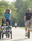 Carol and Dale Huffman have a special bicycle with a wheelchair attached to the front for their daughter Becky, who has cerebral palsy. The family is preparing for a trip to Lima, Peru, to help at a school that serves about 700 people with disabilities.