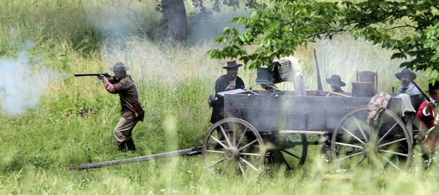 Members of the Pro-Slavers from Missouri fire their guns Saturday during a re-enactment on the actual site of the Battle of Black Jack near Baldwin City in celebration of the battle's 154th anniversary.