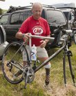 Vietnam veteran Duane Wagner of Arizona unloads his bike Saturday after checking in with race officials. Wagner will be competing in the bike portion for team Operation Rebound in the Kansas Ironman event at Clinton Lake.