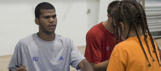 Royce Woolridge signs autographs at the Bill Self basketball camp in this file photo. Woolridge recently made a recruiting trip to Washington State.