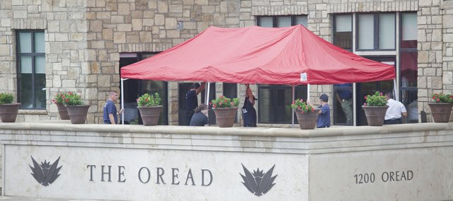 Lawrence emergency workers put up a tent on a second-floor deck at The Oread hotel, where they were investigating a death Tuesday morning. Emergency dispatchers said the death appeared to be from a fall. 
