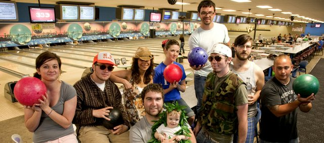 Big Lebowski Party members are, back row from left:  Drew Wille, Austin Brown, Leila Ahvarhoush, Kylie Schwartzkopf, Joel Kelly. Front row from left: Cameron Lauer holding Attie Lauer, Jason Schmits, Erik Moore and A.J. Macasio.
