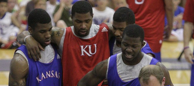 Red team forward Marcus Morris is carried off the court by teammates after suffering an injury during the second half of a scrimmage at the Horejsi Center for Bill Self's annual basketball camp Wednesday, June 29, 2010.