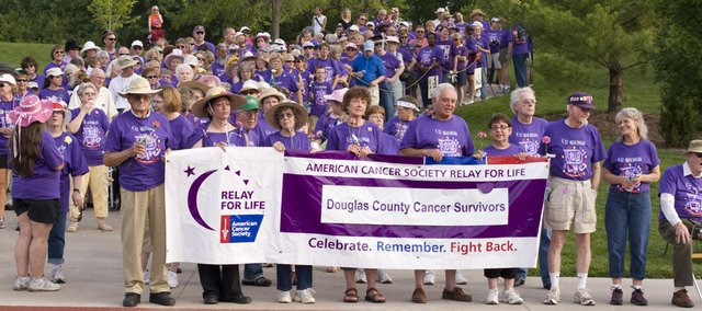 "Cancer survivors gather at the south end of the Free State High School track in preparation for the ""Survivor Lap"" at the Relay For Life event on Friday. The survivors take the first lap around the track to kick off the all-night relay."
