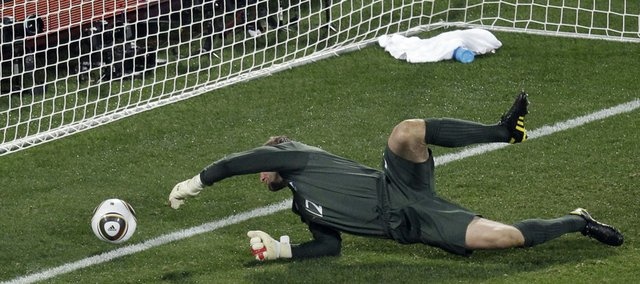 England goalie Robert Green fails to make a save. The goal allowed the United States to come away with a 1-1 tie in the World Cup game Saturday at Royal Bafokeng Stadium in Rustenburg, South Africa.