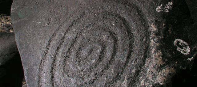 The photograph of this spiral petroglyph in Wrangell, Alaska, revealed more depth and detail by using an off-camera flash directed across the rock face at an angle.