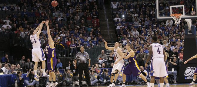 Tyrel Reed (14) launches a three-point shot during KU's 69-67 loss in the second round of the NCAA Tournament to Northern Iowa in this file photo from March 20 in Oklahoma City. Reed said Sunday he played in the NCAAs with a broken big toe.