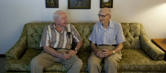 Harold Strub, right, talks with Loren Corliss at his home in Wichita in this photo taken June 3. Strub flew an Air Force rescue plane that picked up B-24 pilot Corliss and seven other men from a Philippine island on Dec. 22, 1944.