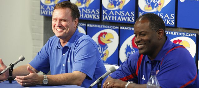 Kansas head basketball coach Bill Self laughs alongside football coach Turner Gill as he responds to a question during a press conference Tuesday at Allen Fieldhouse. Both coaches said they were pleased that the Big 12 conference remains despite the loss of Colorado and Nebraska.