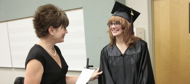 "Brookie Williams, left, secretary at the Adult Learning Center, visits with Ashley Dubree before Dubree was to participate in graduation ceremonies at the GED commencement on Thursday night. ""I'm nervous,"" said Dubree, who was one of two speakers at the ceremony at Free State High School."