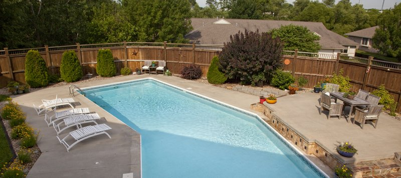 Poolside relief plants soften the landscape for Swimming pool landscaping plants