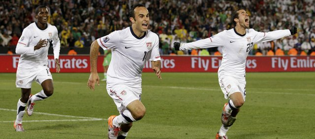 United States' Landon Donovan, center, celebrates after scoring a goal with fellow team members Benny Feilhaber, right, and Edson Buddle, left, during the World Cup group C soccer match between the United States and Algeria at the Loftus Versfeld Stadium in Pretoria, South Africa, Wednesday, June 23, 2010.