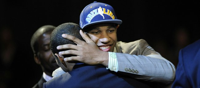 Xavier Henry, right, celebrates with his brother, C.J., after being selected 12th overall by Memphis on Thursday in New York.