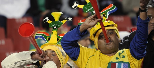 Fans employ the dreaded vuvuzela during a soccer game in Johannesburg, South Africa.