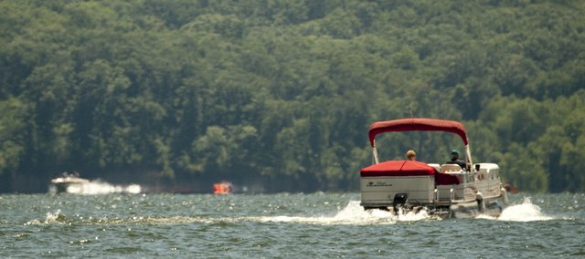 Boat traffic moves on Clinton Lake Wednesday, June 30. The long Fourth of July weekend should boost the local economy with campers and boaters converging on the lake.