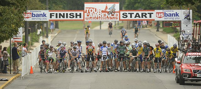 Sixty or so riders line up for the start the men's CAT 4 race of the Tour of Lawrence's KU Campus Circuit Race Saturday on the Kansas University campus.
