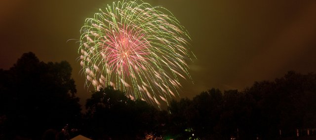 The Jaycees fireworks display went on as scheduled Sunday, a few hours after thunderstorms rolled across the city. The rain dispersed crowds attending the Lawrence Originals festival in Watson Park, but several dozen people returned to watch the 45-minute show.