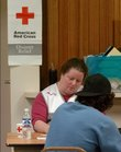 Red Cross Worker Kim High helps a victim of the  Boardwalk Apartments fire in this October 2005 file photo. The Douglas County  Red Cross relies on  Disaster Action Teams, made up of trained volunteers, to offer financial and material help to victims of local disasters.
