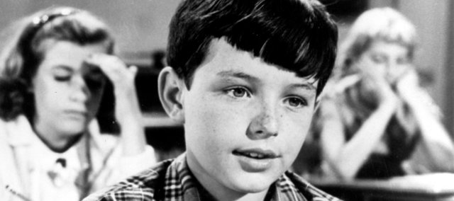 Jerry Mathers, 13, is shown in character as Beaver Cleaver in 1961.
