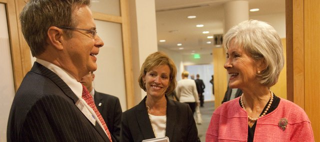 Secretary of Health and Human Services Kathleen Sebelius, right, chats with Kansas University Provost Jeffrey Vitter and Lesa Mitchell, a vice president with the Kauffman Foundation, on Tuesday at the Kauffman Foundation Conference Center in Kansas City, Mo. Sebelius, the former governor of Kansas, was at the conference center for a town-hall meeting on efforts to fight cancer.