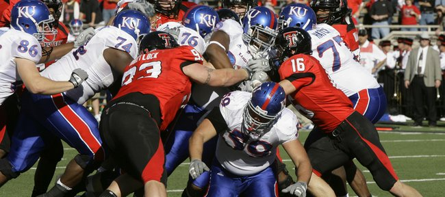 Kansas University's offensive line — in this case, Jeff SPikes (74), Brad Thorson (76), Sal Capra (59) and Jeremiah Hatch (77) — try to get running back Toben Opurum, center, into the end zone against Texas Tech. All those front-liners return, giving the KU coaching staff high hopes for the unit heading into the fall.