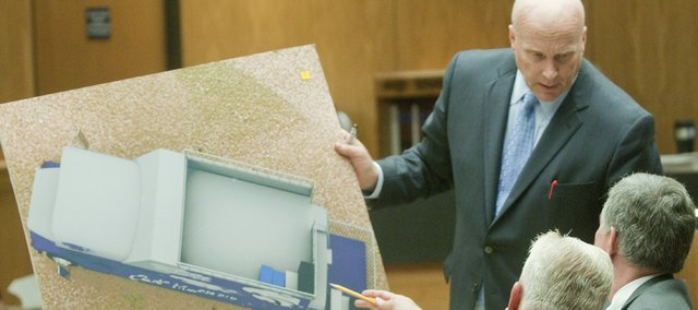 James Thompson, attorney for Samantha Green, the widow of John Green, who was killed in the Cat Tracker accident, displays a computer image of the top deck of the Cat Tracker bus Wednesday during testimony in Douglas County District Court. John Green died Nov. 18, 2006, when he struck his head on the Irving Hill Road overpass as the bus attempted to pass under it on its way to Memorial Stadium for the Kansas University vs. Kansas State football game.