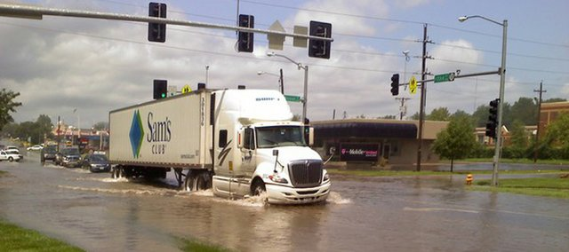 A semi truck attempts to drive through high water at 23rd and Ousdahl just after a severe thunderstorm on Sunday, July 11, 2010.
