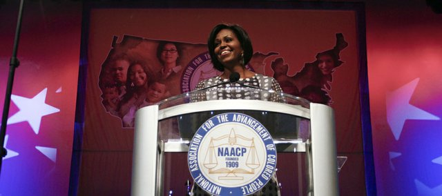 First lady Michelle Obama delivers remarks during the 101st annual NAACP convention, Monday, July 12, 2010, in Kansas City, Mo. During her remarks she talked about the Let's Move! initiative and its goal of solving the challenge of childhood obesity within a generation.