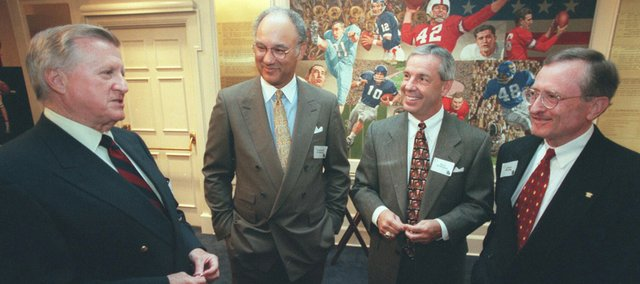 New York Yankees owner George Steinbrenner, left, talks with former National League President Leonard Coleman, left center, former Kansas University basketball coach Roy Williams, right center, and former American League President and KU Chancellor Gene Budig at the dedication of the Budig Hall on KU's campus in October 1997. Steinbrenner died on Tuesday at the age of 80.