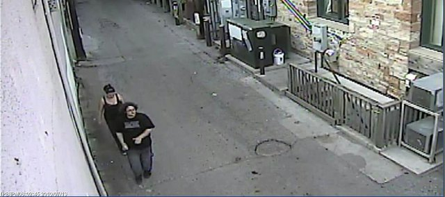 This screenshot from a surveillance camera shows two people the Lawrence Police believe were involved in writing graffiti in the 800 block of Massachusetts on July 13, 2010.