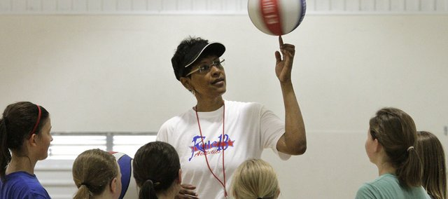 Basketball legend Lynette Woodard, center, works with a group of young players during a Rule 13 basketball camp Wednesday at Bishop Seabury Academy.