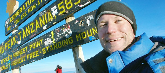 Shawnee Dispatch Sports Editor Chris Wristen stands near the sign marking the Uhuru Peak summit, the highest point in Africa, on June 11. Wristen recently climbed Mount Kilimanjaro in Tanzania, which stands 19,341 feet high and is the highest free-standing mountain in the world.
