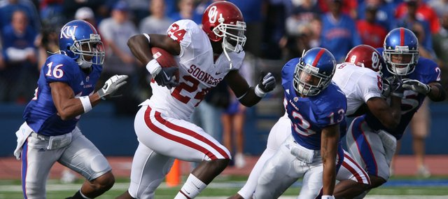 Kansas university defenders Chris Harris (16) and Lubbock Smith (13) chase after Oklahoma receiver Dejuan Miller in this Oct. 24, 2009, file photo at Memorial Stadium. Harris and Smith are expected to play important roles in the KU secondary this fall.