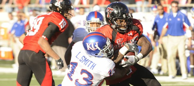 KU's Lubbock Smith tries to drag down Texas Tech's Baron Batch (25) at Jones AT&T Stadium in Lubbock, Texas, in this file photo from Oct. 31, 2009. Smith is one of the top KU safeties on the depth chart heading into the 2010 season.