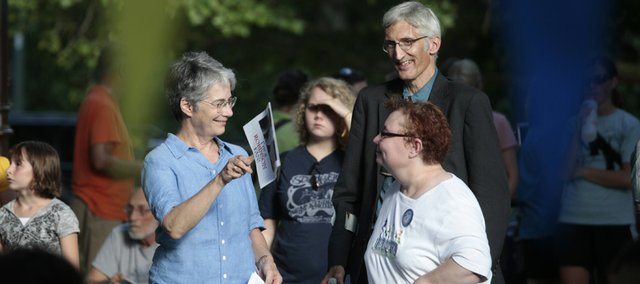 State Sen. Marci Francisco, left, fans Kathy Lobb, Lawrence, a member of the Self-Advocate Coalition of Kansas, at a 20th anniversary celebration of the Americans with Disabilities Act on Monday in South Park. At right is former city commissioner Boog Highberger, Lawrence.