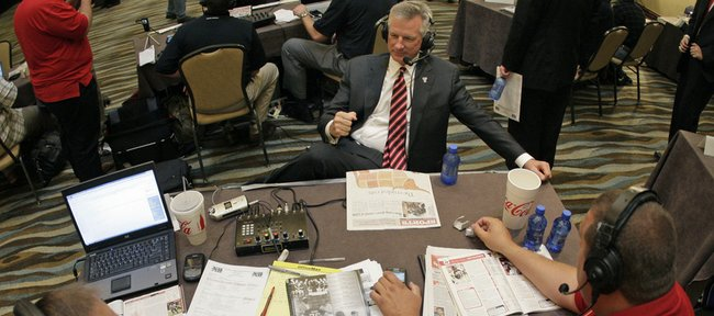 Texas Tech coach Tommy Tuberville, top, answers questions during a radio interview at the Big 12 Football media days on Tuesday in Irving, Texas.