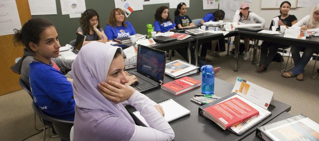 A group of women from Egypt and Morocco are participating in a leadership conference at Kansas University funded by a grant from the U.S. State Department. Yasminah, from left, and Radwa, both of Egypt, listen during a recent session. The women asked that their last names not be used.