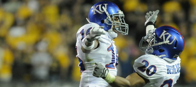 Kansas University defenders Chris Harris and D.J. Beshears (20) celebrate a fumble recovery against Colorado on Oct. 17, 2009, in Boulder, Colo. Harris, a senior cornerback, is hoping to use his experience, 	dependability and passion to create a memorable final year on the football field in 2010.