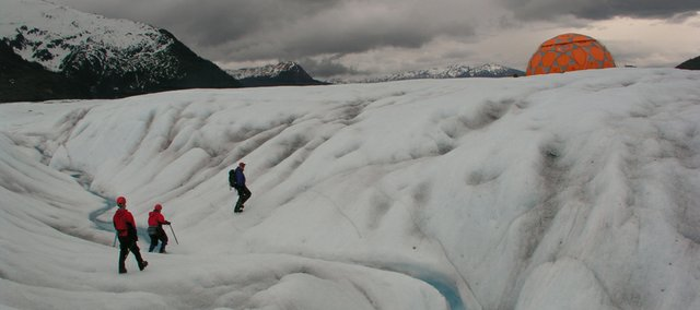 A helicopter trip to the Mendenhall Glacier, outside Juneau, Alaska, offered aerial shots as well as surface landscapes of the expansive ice flow. By lagging behind the group of hikers I was able to capture photographs that showed the relationship of the figures to the large landscape.