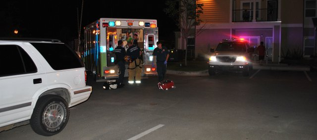 Emergency crews load a victim of the Sunday morning shooting into an ambulance before transporting the patient to an area hospital. Three people were reported injured during the incident.