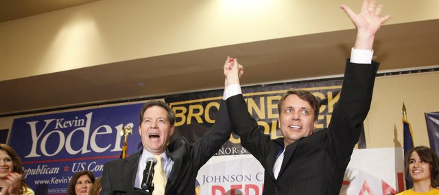 Republican gubernatorial candidate, Sen. Sam Brownback, left, raises hands with his candidate for Lt. Governor, Kansas senator Jeff Colyer, at the Overland Park Marriott for a watch party organized by the Johnson County Republican Party, Tuesday, Aug. 3, 2010.