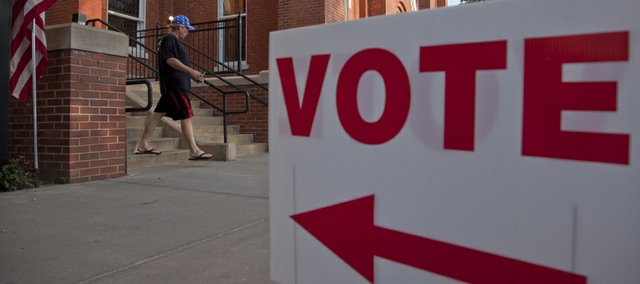 A voter leaves the poll at Plymouth Congregational Church shortly after 7 a.m. Tuesday, August 3, 2010.